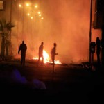 Egypt protesters torch buildings, target Suez Canal