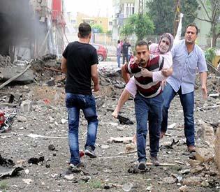 human rights observers 40 dead in turkey car bombing near Syria arab uprising
