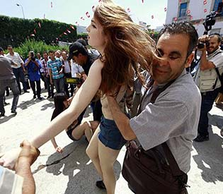human rights observers - Europeans topless protesters may face 2 years in prison intl. news1