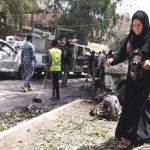 Iraqi officials say 20 dead many injured in fresh bombings in Baghdad