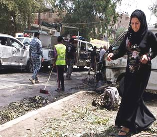 human rights observers - Iraqi officials say 20 dead many injured in fresh bombings in Baghdad arab up