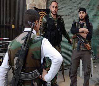 human rights observers Syrian troops battle rebels in Aleppo prison arab uprising 1
