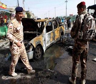 human rights observers - atracks kill 95 in iraq, hint of syrian spillover arab uprising 1