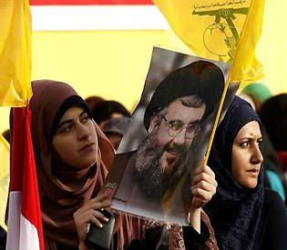 human rights observers - Barrage of rockets from Syria hit Hezbollah stronghold arab uprising1