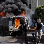 Bombs hit Syrian capital Damascus, Aleppo kill 20 soldiers