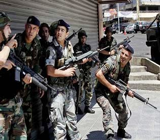 human rights observers - Intense clashes rage overnight lebanon 12 slodiers killed arab uprising1