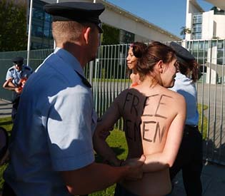 human rights observers - Police break up topless protest in Berlin eu crisis1