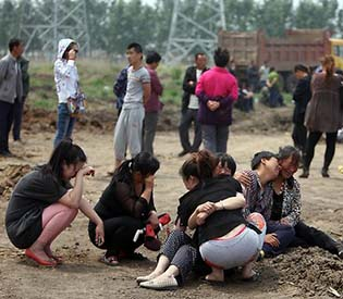 human rights observers - Poultry plant Fire kills 119 people in northeast China intl. news1