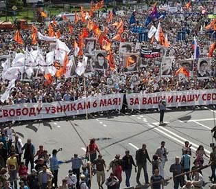 human rights observers - anti-putin protesters march in Moscow decrying presidents rule eu crisis