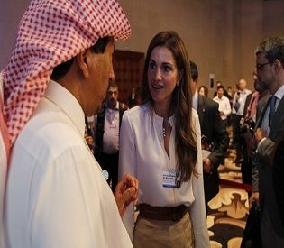 Jordan's Queen Rania speaks with Saudi Arabia's Prince Saud Al-Saud after attending the plenary session on the second day of the World Economic Forum on the Middle East and North Africa, at the Dead Sea
