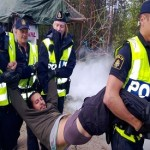 Activists scuffle with Swedish police over mining