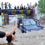 Pakistan warns of more rain after flood deaths hit 80