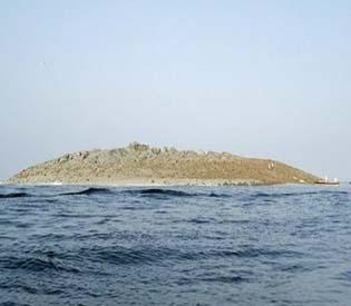hromedia - Muddy island formed by Pakistan quake