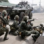 Philippines warns rebels to end hostage standoff