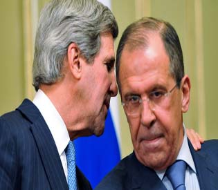 U.S. Secretary of State Kerry whispers to Russian Foreign Minister Lavrov during a joint news conference after their meeting in Moscow