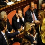 Italy PM survives vote after Berlusconi about-face