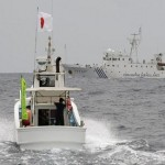 Japan's Abe realigns military, cautions China