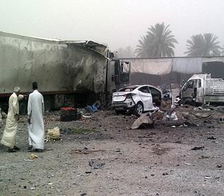 Civilians gather at the site of a car bomb attack at Jadidat al-Shatt in Diyala