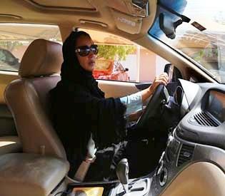 Saudi men work to put women behind wheels