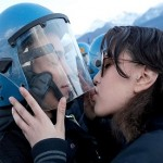 Italian police want student charged for kissing riot policeman