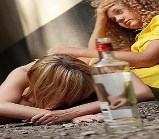 Drunk teens with vodka bottle