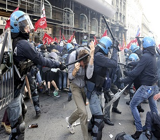 Demonstrators fight with policemen during a protest in downtown Rome