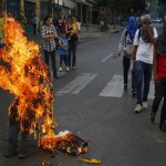 Venezuela unrest: Violence reignites in Caracas as protesters burn Maduro puppets