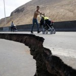 Weary Chileans flee as earthquake aftershocks continue