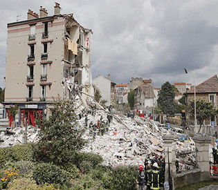 Explosion fells building outside Paris, killing at least 2
