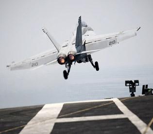 U.S. planes strike militants near Iraq's Amreli, airdrop aid