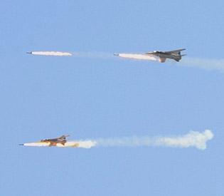 hromedia Syrian planes bomb border post near Israel captured by rebels