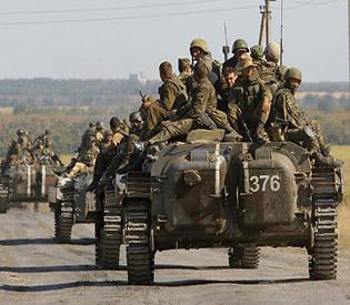 Ukraine, rebels trade 67 prisoners in peace deal