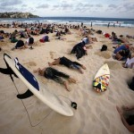 Australians bury heads in sand to protest government climate stance