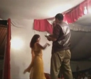 hromedia India Cop forces female dancer to perform at gunpoint intl. news3