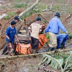 Indonesia rescuers use hands in search for scores missing in mudslide