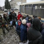 Civilians flee from Ukraine front line town after truce agreed