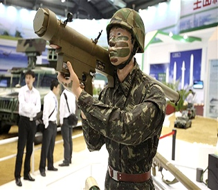 China airshow...epa03469707 A mannequin holding a FN-16 MANPAD Air Defense Missile Weapon System from ALIT China Aerospace Long-March International is seen on display at the International Air Show in Zhuhai, China, 13 November 2012. The Air Show, the largest of its kind in Asia, runs from 13 to 18 November 2012.  EPA/DIEGO AZUBEL