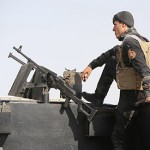 IS seizes Iraqi govt compound, kills dozens in Syria