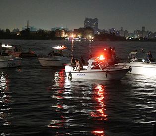 21 dead as cargo ship hits party boat north of Cairo