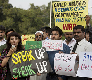 Activists from Pakistan's Child Rights Movement, rally to condemn a child abuse scandal, Monday, Aug. 10, 2015 in Islamabad, Pakistan. Police in eastern Pakistan arrested several men accused of sexually abusing children and distributing videos of the abuse, authorities said Sunday. More arrests were expected.  Poster in Urdu reads: 'Stop Child Abuse'. (AP Photo/B.K. Bangash)