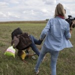 Hungarian camerawoman fired after intentionally kicking, tripping refugees