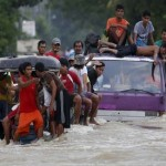 Flood misery in Philippines after Typhoon Koppu kills 58