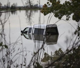 A truck sits in the flooded waters of the Stillaguamish River in Stanwood, Washington