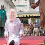Crowd cheers as woman is brutally caned for crime of Affectionate Contact