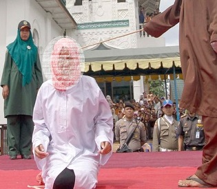 hromedia Crowd cheers as woman is brutally caned in Indonesia for crime of Affectionate Contact intl. news3