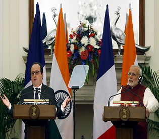French President Hollande delivers his press statement as India's Prime Minister Modi looks on at Hyderabad House in New Delhi