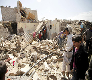 People inspect damage at a house after it was destroyed by a Saudi-led air strike in Yemen's capital Sanaa