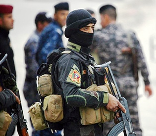 Suicide bombers kill three soldiers in attack on Iraq base
