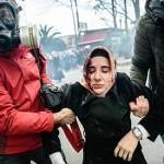 Turkey newspaper defiant after raid as police disperse protests