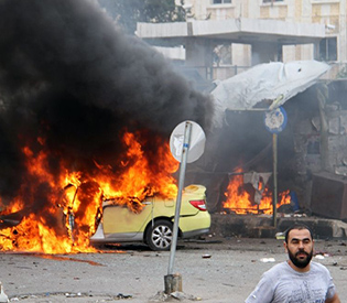 IS blasts in Syria regime heartland kill more than 148